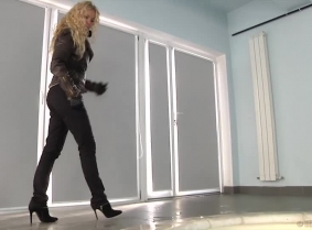 Julia looks really good into the pool, her winter outfit looks absolutely great when soaked. During the clip, Julia removes her leather jacket and her ankle boots showing her nyloned feet to the camera.