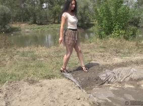 Andrea's sexy outfit look awesome covered with mud and this is the first clip where she completely covered herself, face and hair too. Wash off  session available.