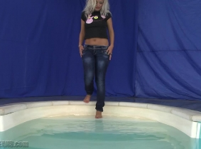 """""""Finally"""" we have an update for the barefeet fans, it's a special update, made by request for a custom-videos.com customer.  Judith is playing in the pool wearing tight jeans and a black t-shirt without bra underneath."""