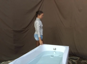 Alehandra is taking a bath, and to make the session a little more special, we took the bath tub outdoor. Alexandra is wearing short pants, sport shoes, pantyhose and a sweater without bra underneath.